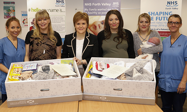First-time mothers are receiving boxes full of essential items for their babies, which can even serve as their first bed once empty.