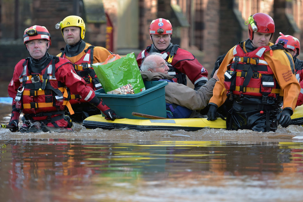 A rescue team helps to evacuate people from their homes after Storm Desmond caused flooding on December 6, 2015 in Carlisle. Photo by Jeff J Mitchell/Getty