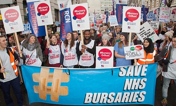 Protestors holding 'Save NHS bursary' sign