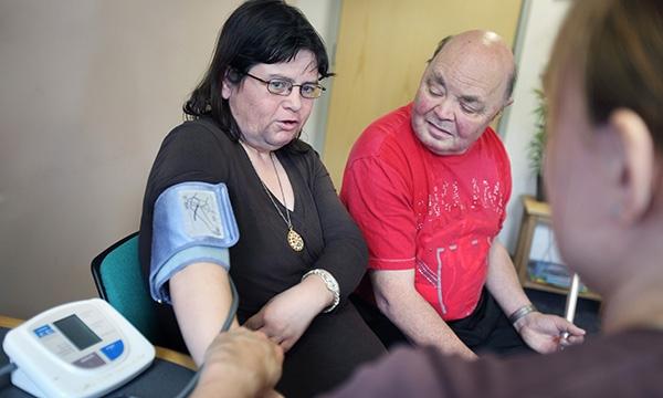 Nurse conducting health checks with patients