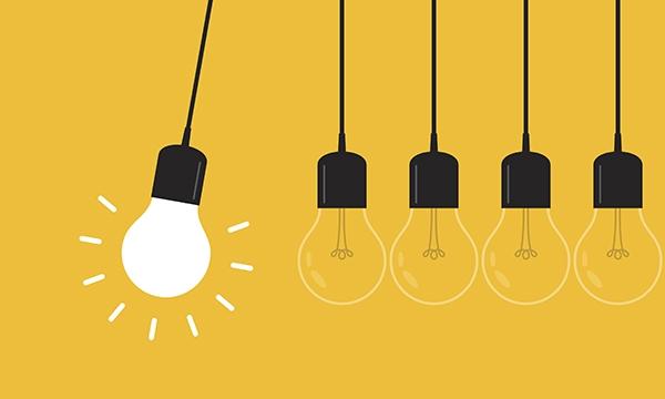 Several lightbulbs, one illuminated