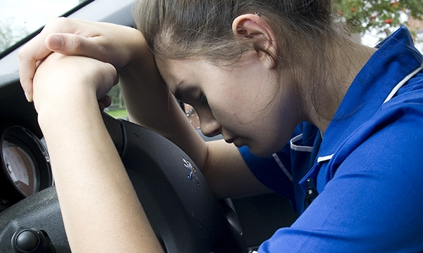 Nurse in car
