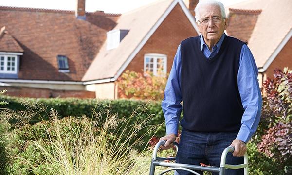 Older man with walking frame