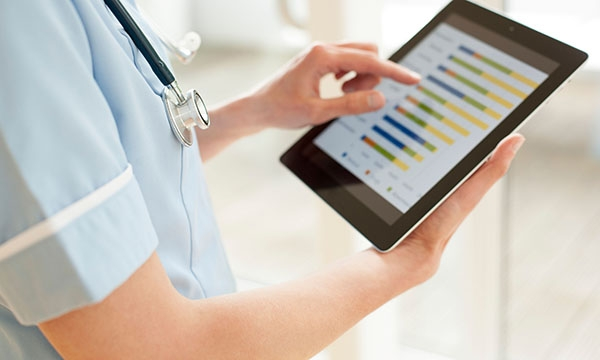 Nurse using tablet computer